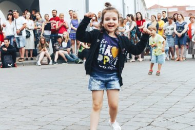 July 21, 2018 - Minsk,Belarus: Street walks. children dancing on square in front of group of people