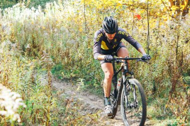 October 14, 2018 - Minsk, Belarus: 2018 Olympic Cross Country Cup XCO in Medvezhino man riding bicycle along forest trail