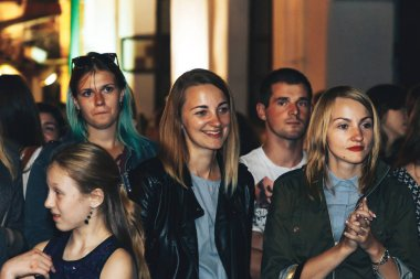 September 1, 2018 - Minsk, Belarus: Street festivities in evening city, people standing on street during event