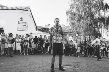 August 4, 2018 Street festivities in the evening city A man with a microphone sings in front of people on the street