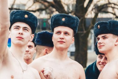 February 23, 2019 Minsk Belarus The race in honor of the holiday on February 23 A bare-chested soldier takes a selfie on the phone among other soldiers