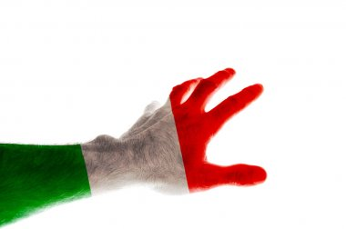 The hand of a mature man painted in the colors of the flag of Italy stretches forward with his fingers spread Image dedicated to the national holiday of Italy Republic Day June 2 Isolated on white background.