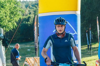 May 26-27, 2018 Naliboki,Belarus All-Belarusian amateur marathon Naliboki A man is riding a bicycle on the road