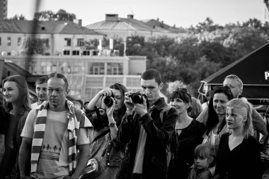 June 1, 2019 Festivities in the city on the day of Swedish culture In the black-and-white image, a man and woman are standing on the street with cameras.