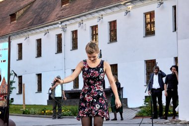 May 25, 2019 Minsk Belarus A theatrical performance in which a young woman with a microphone sings in the street