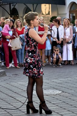 May 25, 2019 Minsk Belarus A street concert in which a beautiful woman with a microphone sings
