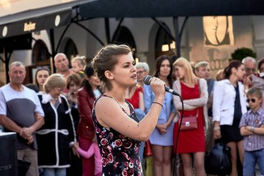 May 25, 2019 Minsk Belarus A street concert where a young woman with a microphone sings in front of a crowd of people