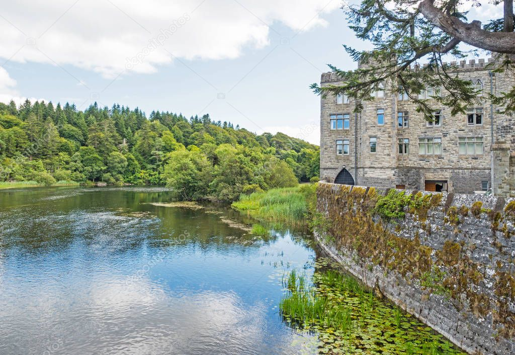 ASHFORD CASTLE, IRELAND - AUGUST 10, 2018: Ashford Castle is a medieval and Victorian castle that has been turned into a five-star luxury hotel near Cong in Ireland. It overlooks Lough Corrib.
