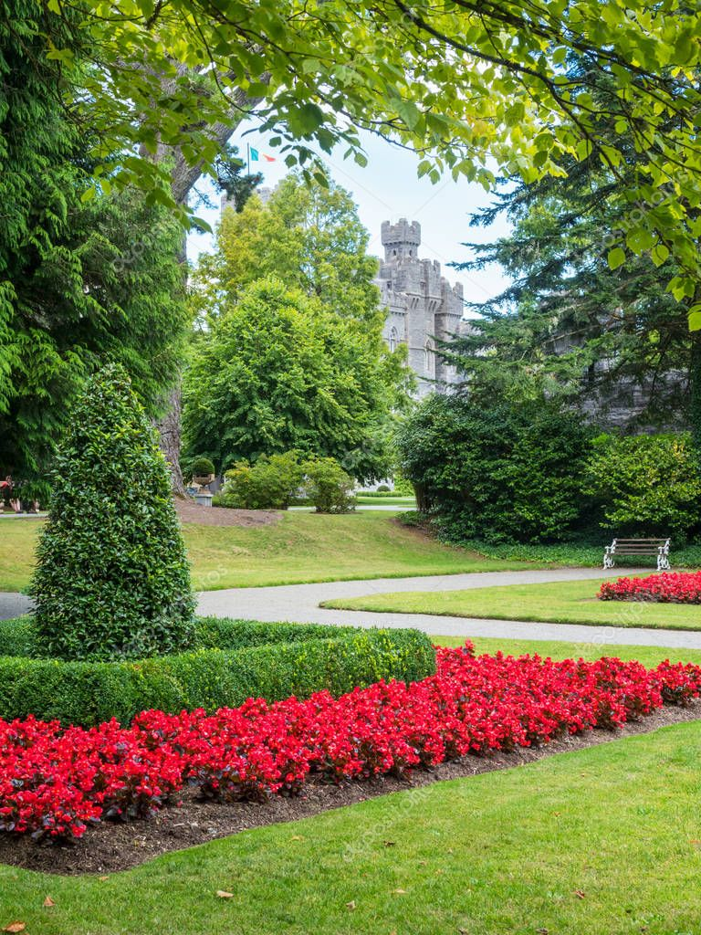 ASHFORD CASTLE, IRELAND - AUGUST 10, 2018: The garden at Ashford Castle, a medieval and Victorian castle that has been turned into a luxury hotel near Cong on the Mayo-Galway border in Ireland.