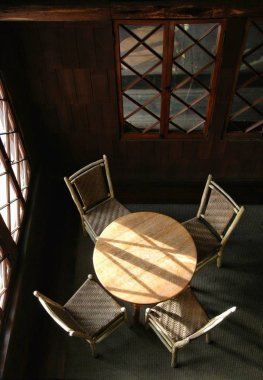 table and chairs in a quiet corner of a rustic lodge