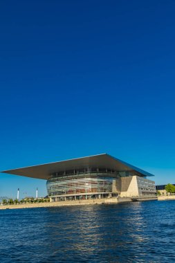 COPENHAGEN, DENMARK - JUNE 13, 2018: View at Copenhagen Opera House in Denmark. This neofuturistic building was opened in 2005 and now is among the most modern opera houses in the world.