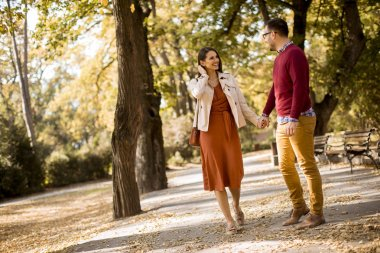Lovely young couple walking in the autumn park