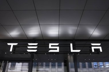 BASEL, SWITZERLAND - SEPTEMBER 24, 2018: Detail from Tesla store in Basel, Switzerland. It is an American company that specializes in electric automotives founded at 2003. stock vector