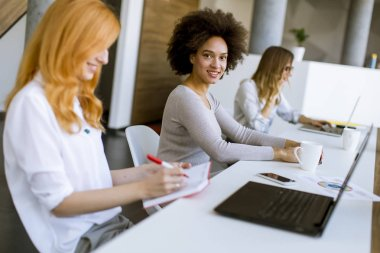 Young businesswomen working in modern office