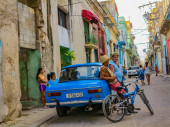 HAVANA, CUBA - NOVEMBER 24, 2015: Unidentified people on the street of Havana, Cuba. It is Cuba capital city with Spanish colonial architecture.