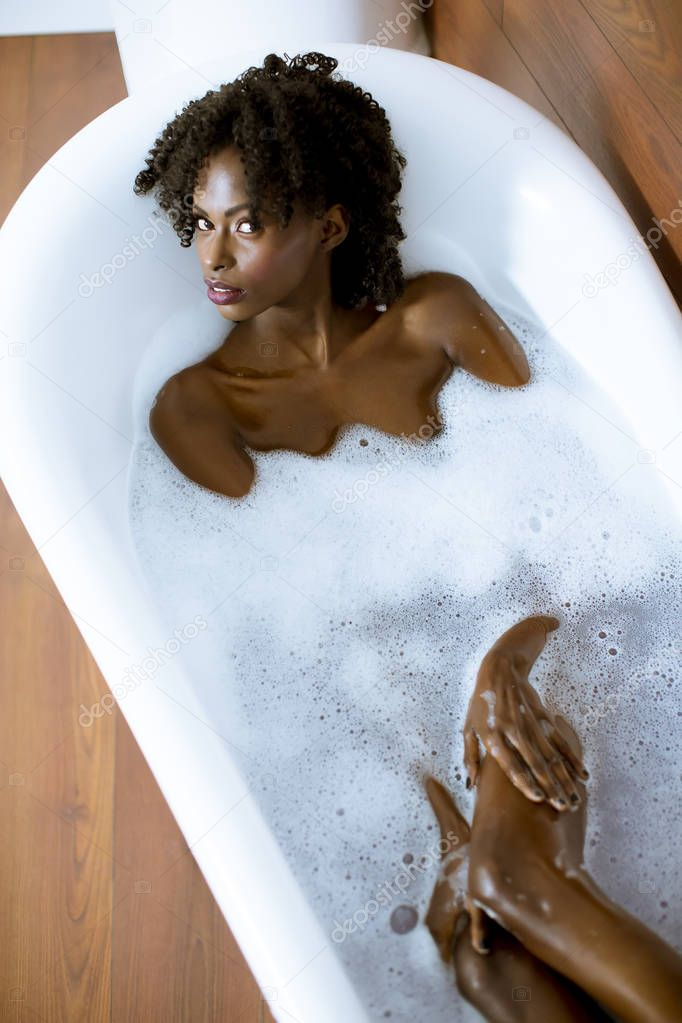 Woman Back In The Bathtub Stock Offset 4tube 1
