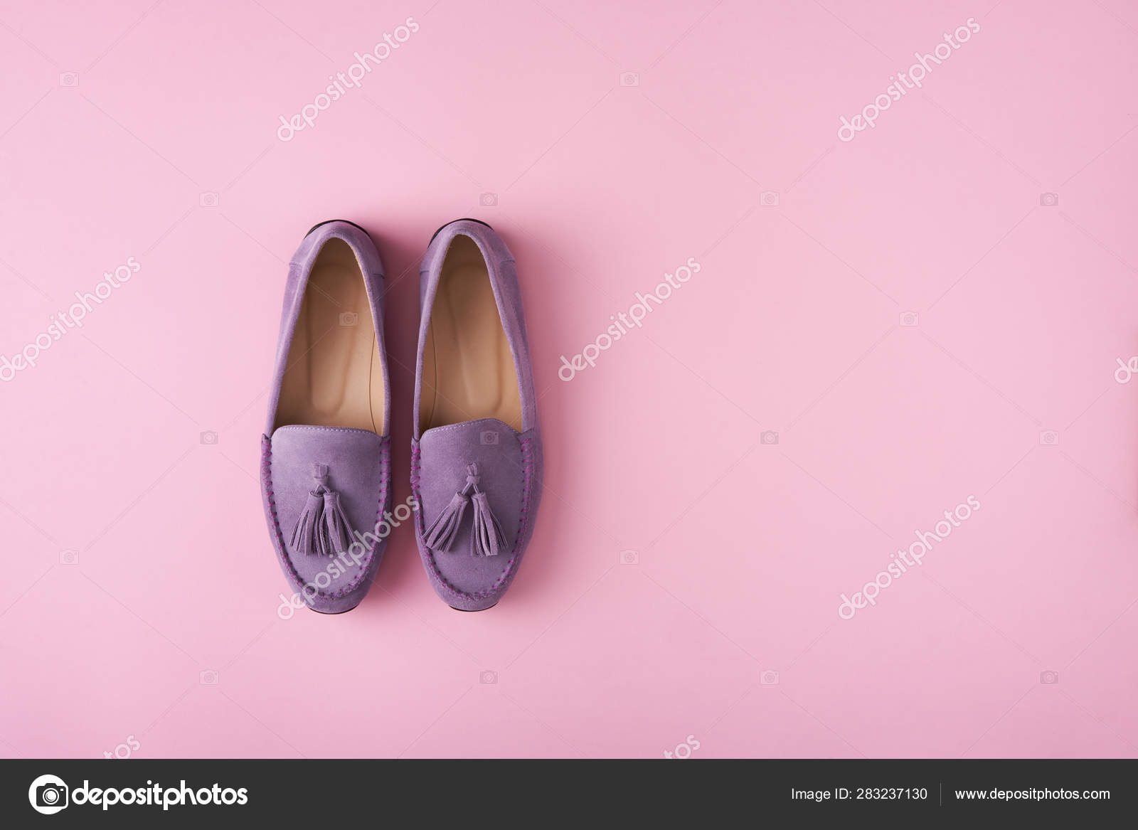 Lilac suede moccasins shoes over lilac