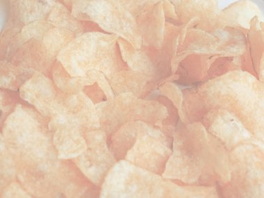 detail of crisps potato chips snack food, delicate soft faded tone useful as background