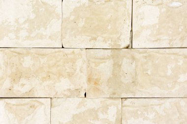 Wall with yellow marble panels. Beautiful background. Imitation of natural material. Free surface.