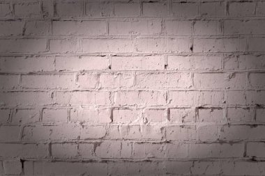 Empty brown background, dark beige brick wall. Texture of masonry. Beautiful pattern with vignette.