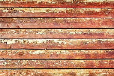 Fence of flat boards. Wooden horizontal slats. Beautiful background with a texture of old wood with a cracked paint.