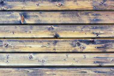 Wall with wood texture. Fence from horizontal boards. Brown background.