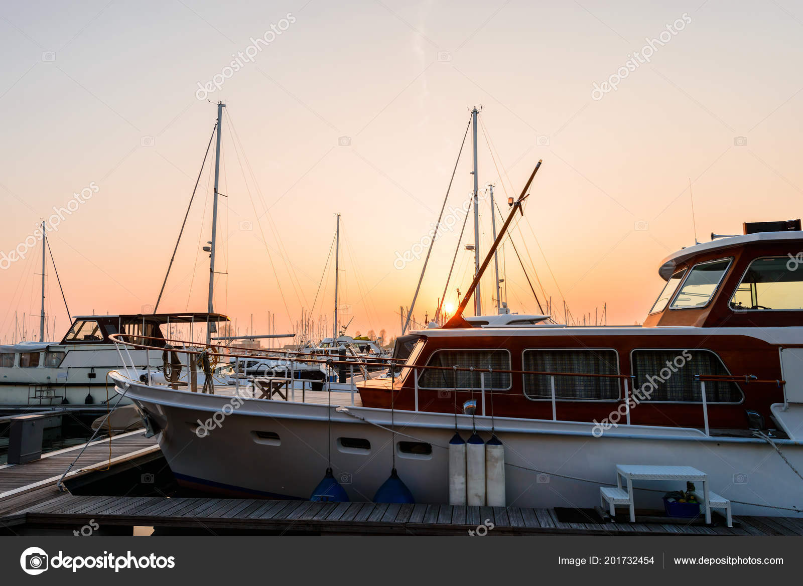 Modern sailboats and luxury yachts parked in the seaport at