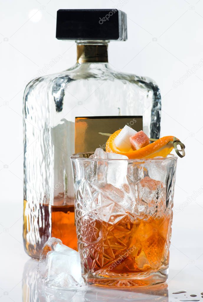 Alcoholic Cocktail with whiskey, ice, orange and sugar