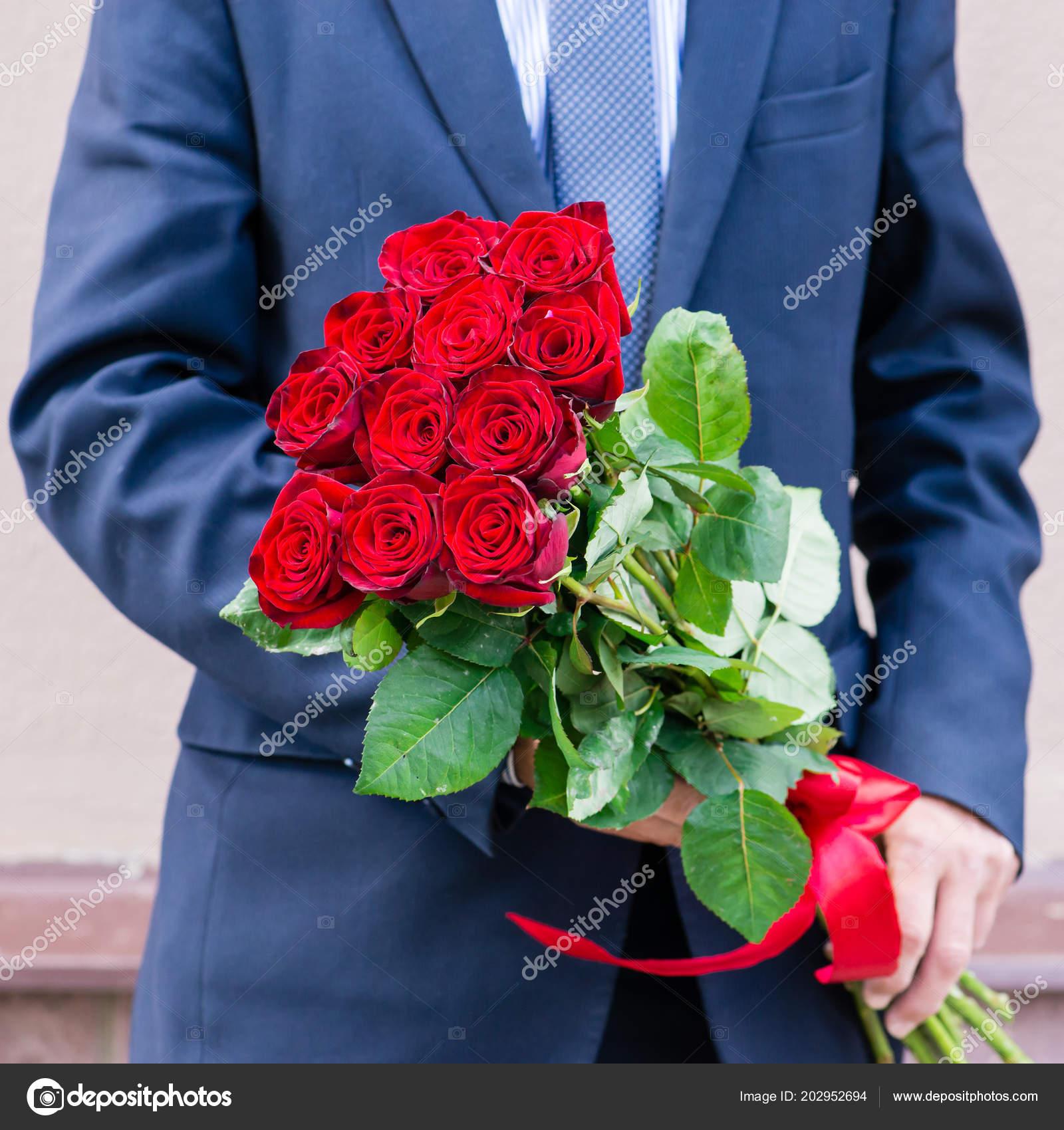 Mazzo Di Fiori Uomo.Man With Bouquet Of Flowers Stock Photo C Smspsy 202952694