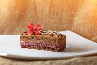 Delicious chocolate cake with red mastic flower and powdered sug