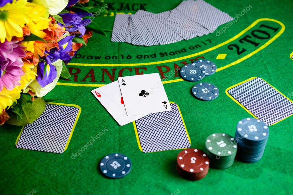 Concept of casino, playing cards and money. Stacks of poker chip