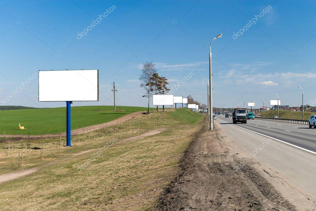 large billboards near the highway transportation hub