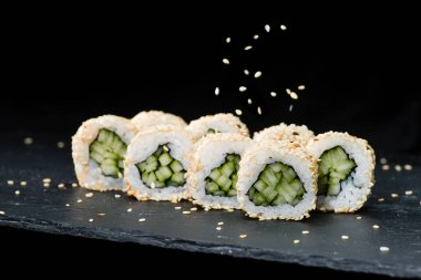 Traditional Japanese cuisine.  Selective focus on sushi rolls wi