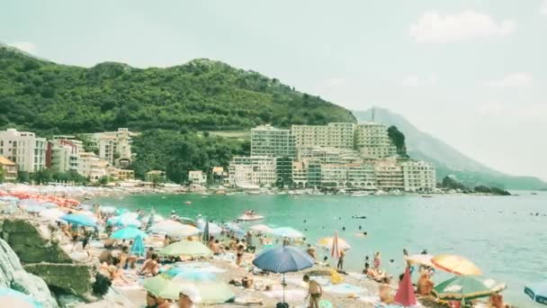 BUDVA, MONTENEGRO - AUGUST 1, 2018. Time lapse of crowded Becici beach on a summer day