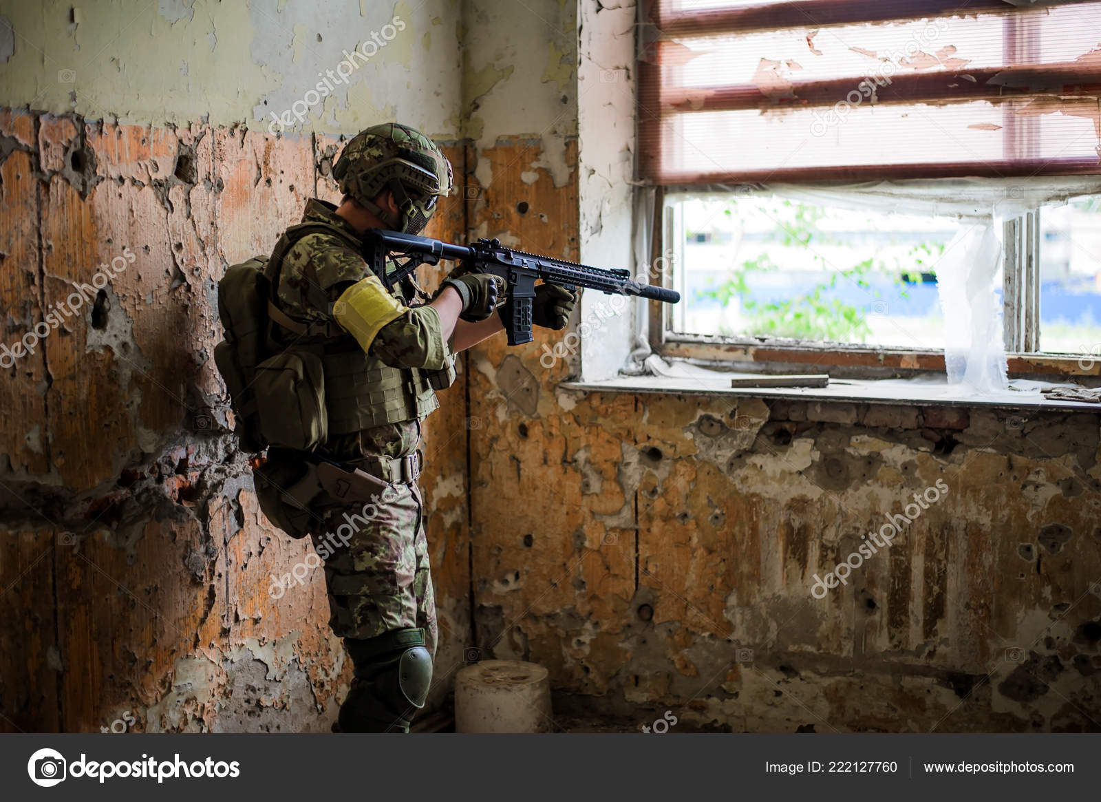 military man sniper automatic rifle window old abandoned building
