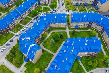 OLKUSZ, POLAND - JUNE 03, 2020: Aerial view of the housing estate with blue roofs. Estate Sloviki located on Witosa street is also called
