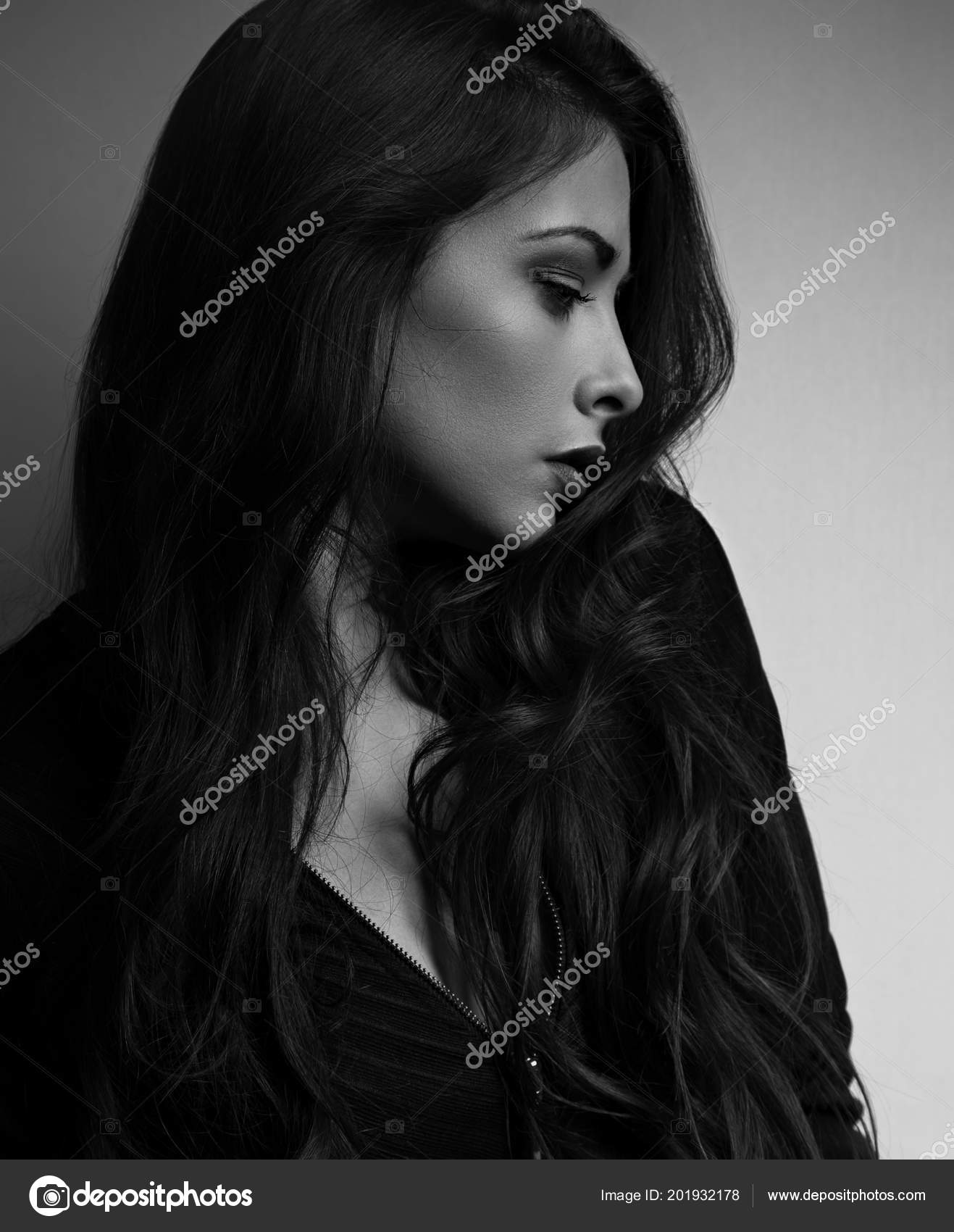 Thinking emotional beautiful woman profile looking long hair dark