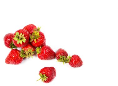 Ripe red strawberries on a white background