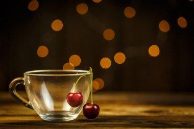 Ripe cherries on a brown table, beautiful bokeh