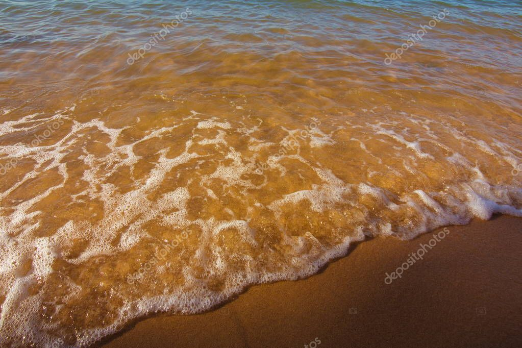Texture background with sea water and sand on the beach