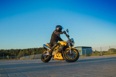MINSK, REPUBLIC OF BELARUS - July 21, 2017: Competitions in driving a motorcycle club Motogymkhana-Minsk. Driving skills among beginners and experienced pilots, among cones and artificial obstacles.
