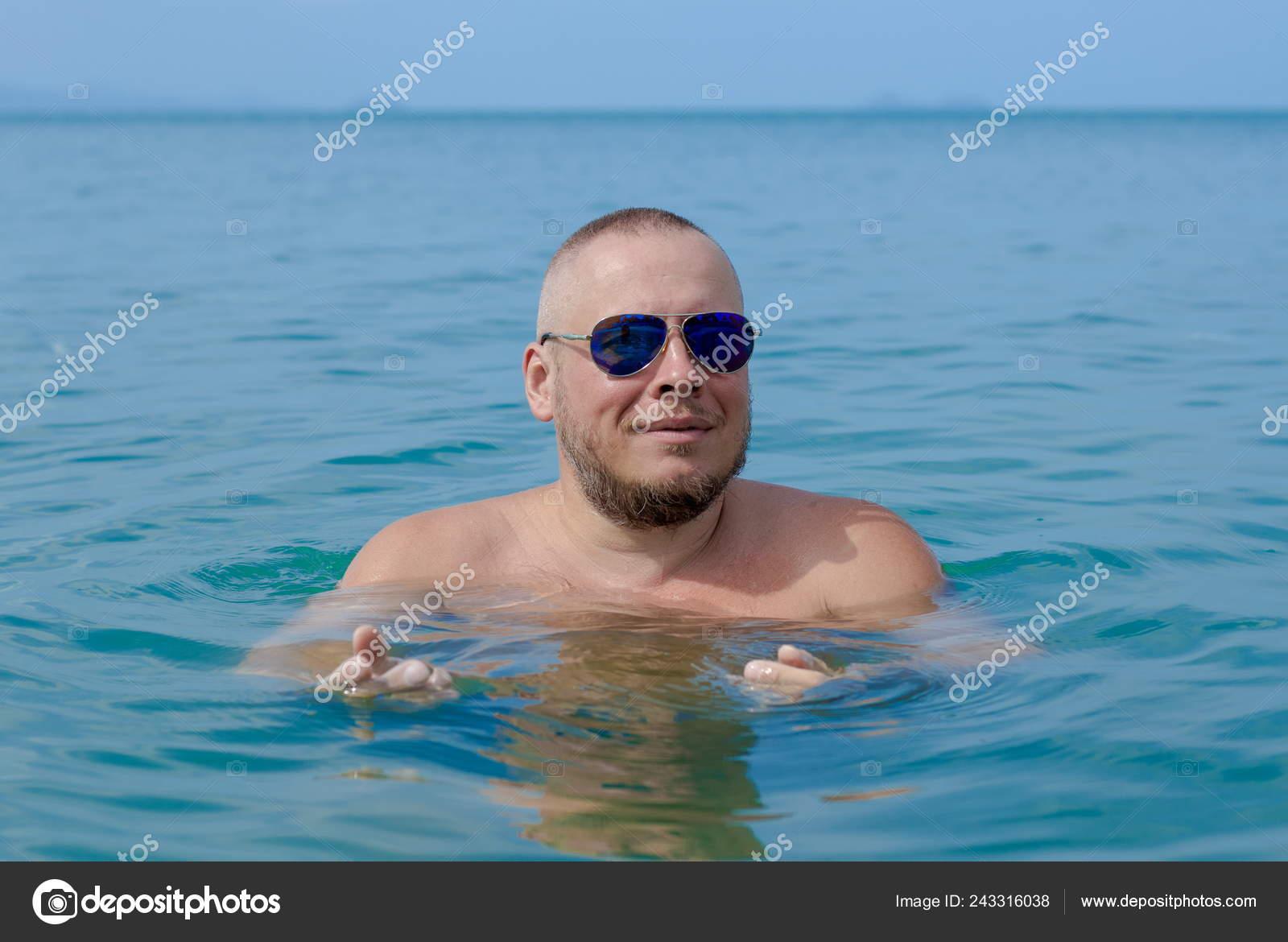 Tanned Man Nude Torso Sunglasses Posing Beach Sea Sunset Stock