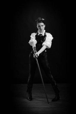 beautiful emotional woman in steampunk costume posing in studio