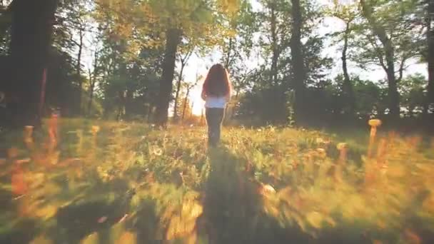 little girl is walking in the forest