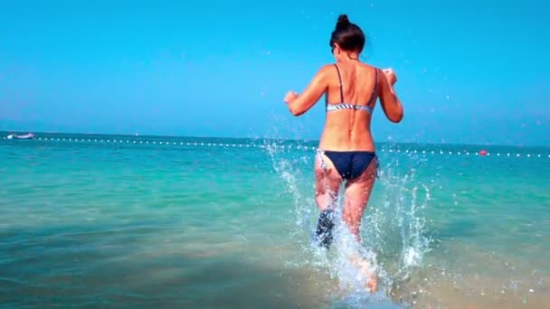 Slow Motion: woman playing with sea water