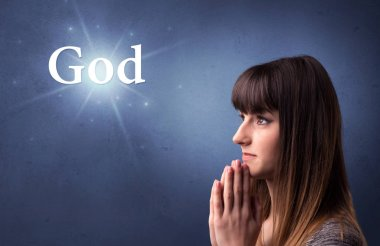 Young woman praying on a blue background with the word God written above her stock vector