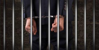 Close handcuffed man in jail