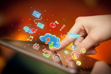 Fingers touching tablet with social icons
