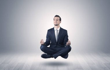 Businessman levitates and sitting in yoga position in an empty infinity space stock vector