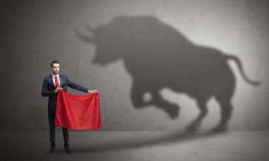 Businessman with bull shadow and toreador concept